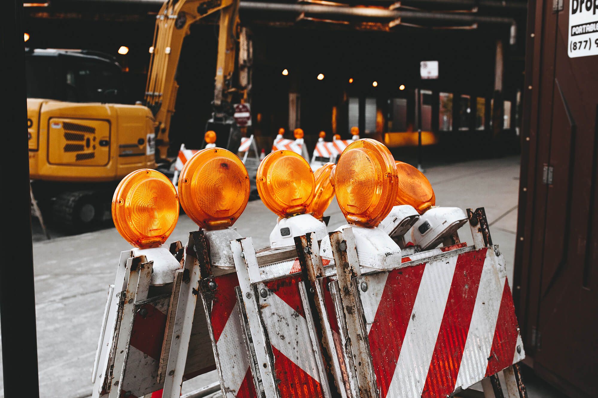 Caution signs with a excavator