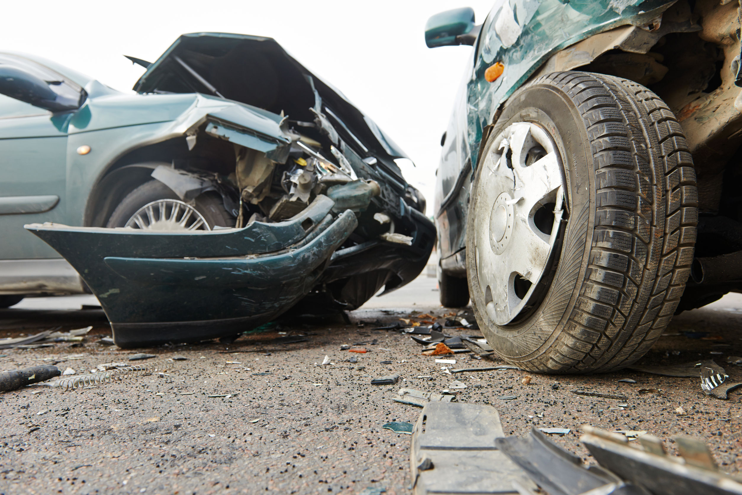 Close-up of two cars next to each other after a crash