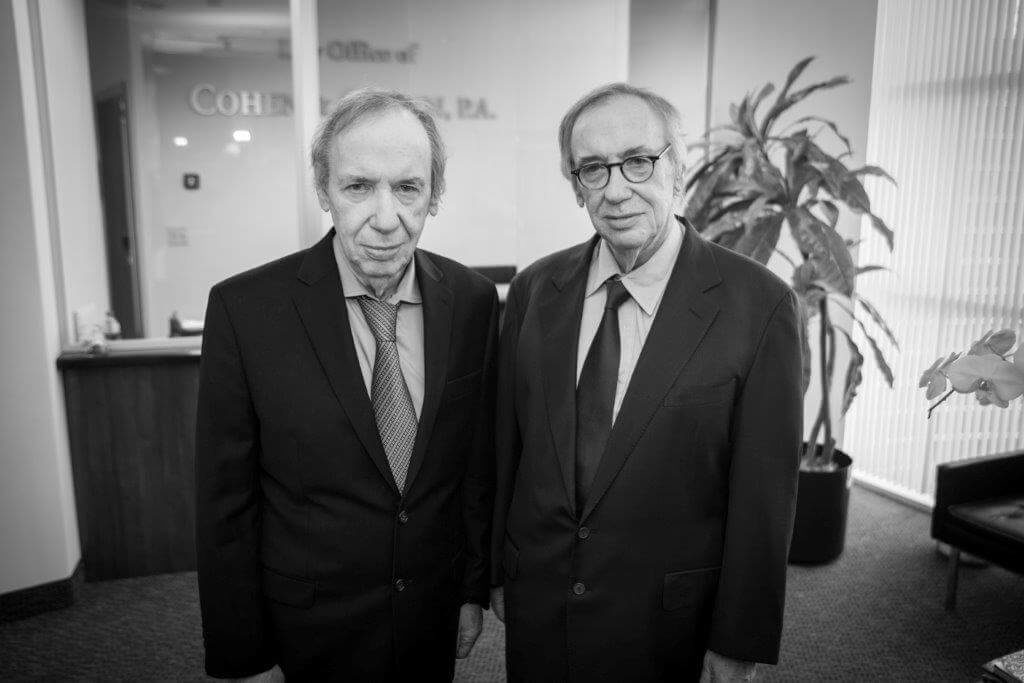 Bernard Cohen and Irwin Cohen standing side by side