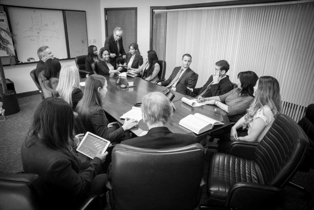 The Law Firm of Cohen & Cohen team sitting in a boardroom