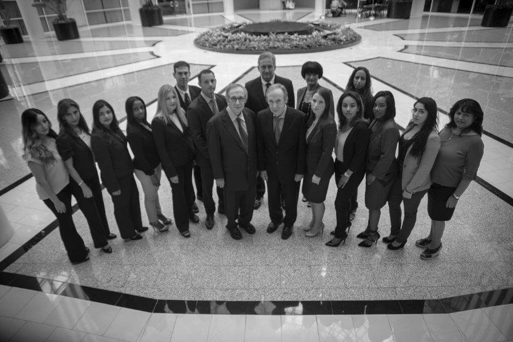 The Law Firm of Cohen & Cohen team standing together