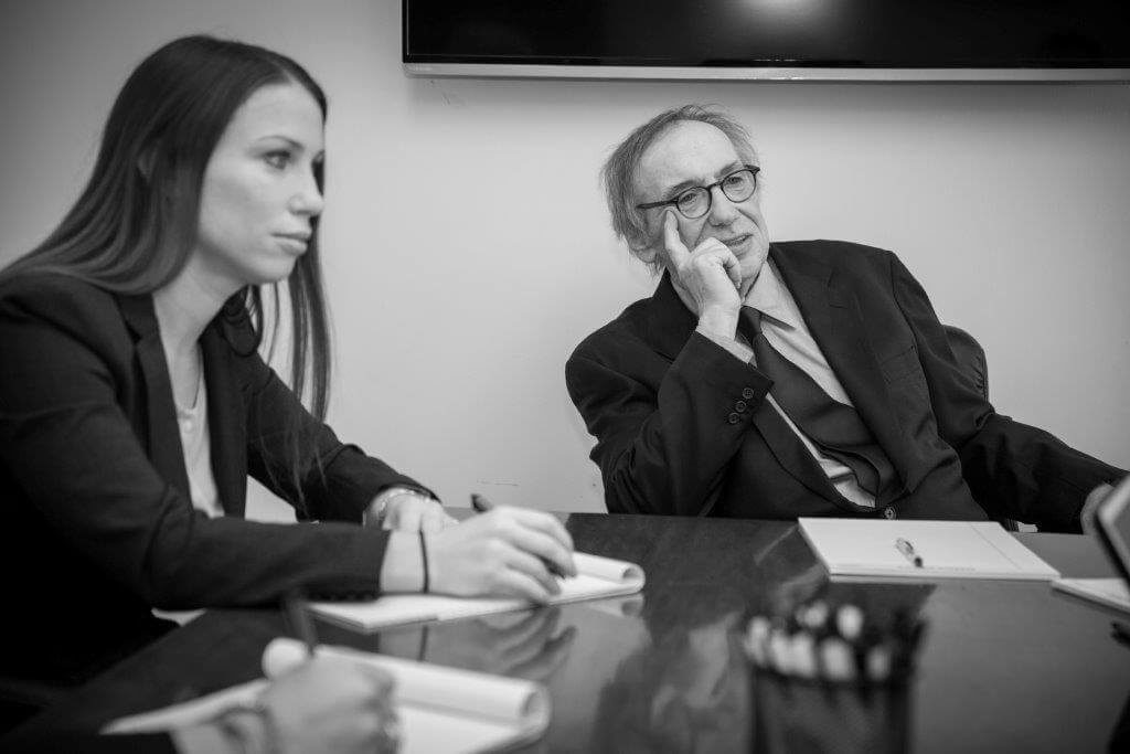 Sarah Cohen sitting at boardroom table next to Irwin Cohen